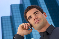 Businessman on cell phone outside office building